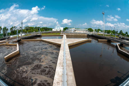 Water treatment facility with large pools of water Фото со стока