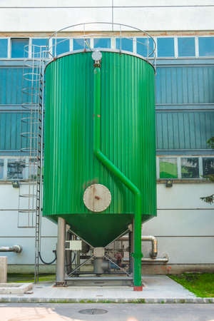 Modern fluid tank outdoors in green color photo