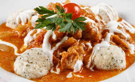 cooked pepper ball: Delicious stew on the wooden table Stock Photo