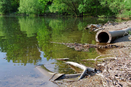 pollution water: Large pipes running into the lake damaging the environment