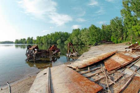 Metal scrap at the shore closeup