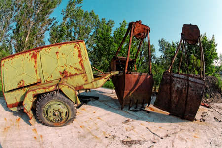 Large industrial machine on the shore of a lake photo