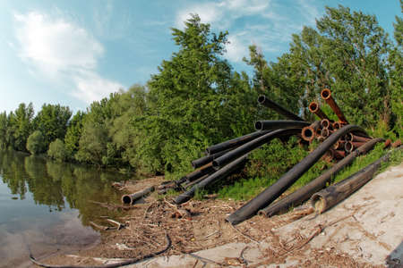 damaging: Large pipes running into the lake damaging the environment