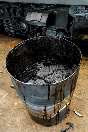 Damaged oil drums in industrial interior closeup