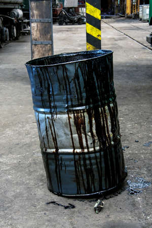 Damaged oil drums in industrial interior closeup photo