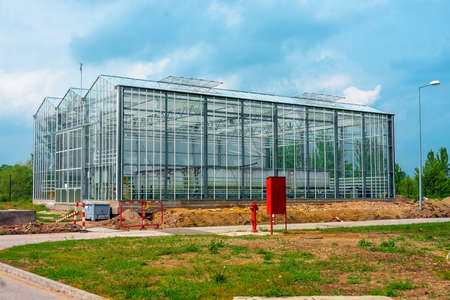 Large greenhouse outdoors with blue sky Stock Photo - 22792194