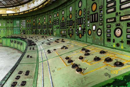 Illuminated control room of a power plant with meters