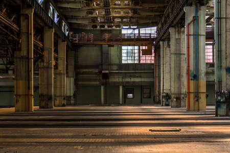 abandoned factory: Dark industrial interior of an old building