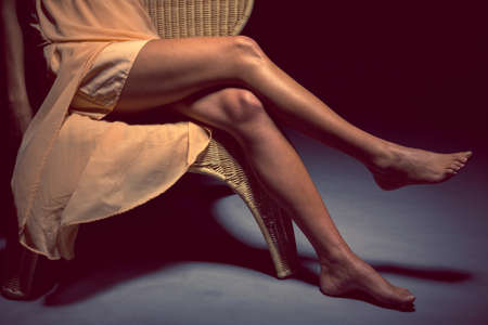crossed legs: Legs of a woman in dark