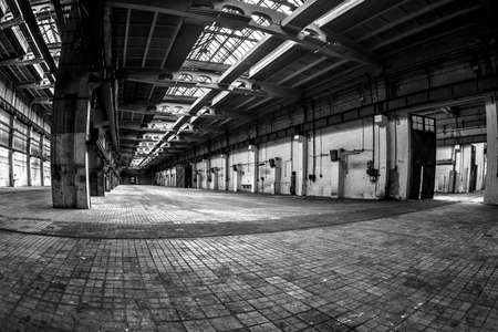 Dark industrial interior of an old building photo