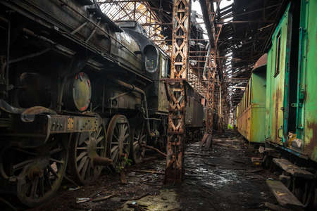 Old trains at abandoned train depot