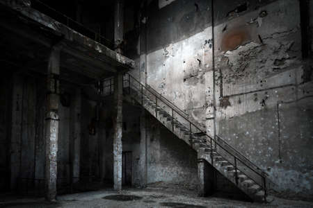 industry inside: Abandoned industrial interior with stair