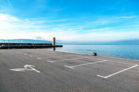 and the area: Empty parking area with sea landscape