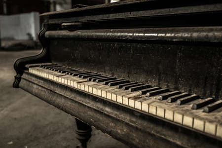 Close up of old dirty piano photo