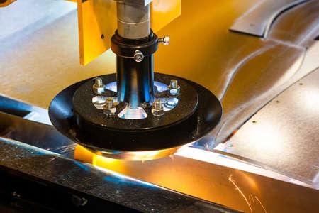 Machine cutting steel in a factory photo