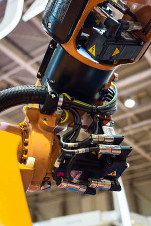 Industrial robot arm close up photo