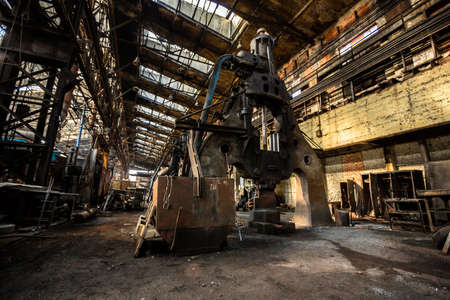 high torque: Abandoned industrial interior with hammer