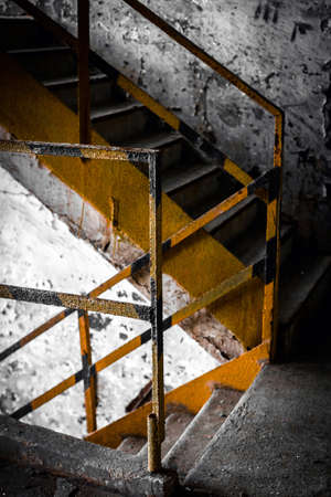 stair in old and dirty building of factory. photo