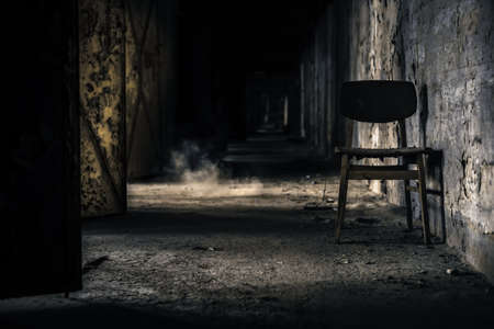 Abandoned interior with chair and door