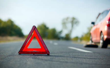Red triangle of a car on the road Standard-Bild