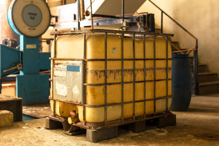 Industrial interior with chemical tanks photo