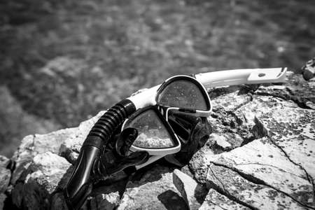 diving goggles on the beach photo