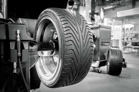 maintenance fitter: Wheel balancing close up