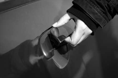 Hand of a man opening car door photo