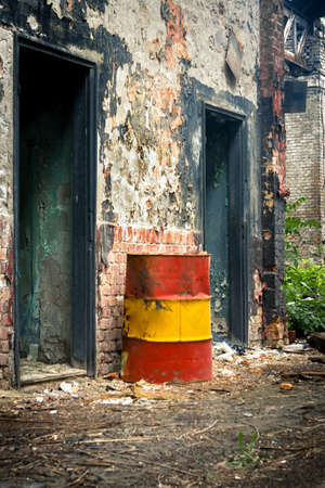Damaged oil drums in industrial interior photo