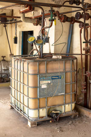 Industrial interior with chemical tanks closeup photo