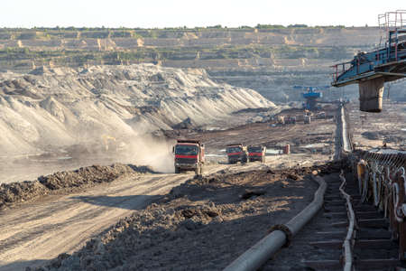 mine site: Landscape with mine machine on sunny day against blue sky