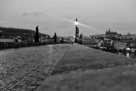 charles bridge: Charles Bridge in Prague at dawn Czech Republic in black and white
