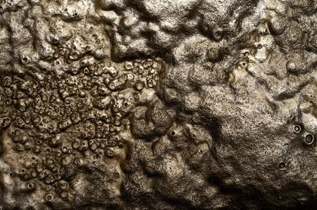 Melted, bubbled rubber surface, excellent for background