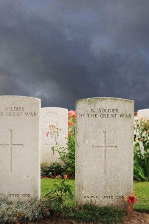 Graves of unknown fallen soldiers in World War I at Tyne Cot cemetery in Passchendaele, Ypres, Flanders photo