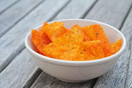 White bowl with paprika doritos, shallow dof Stock Photo