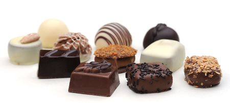 bonbons: Belgian chocolates on white, shallow depth of field