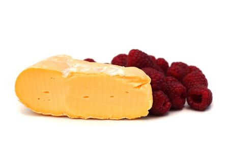 raspberry and french cheese on white, shallow dof Stock Photo