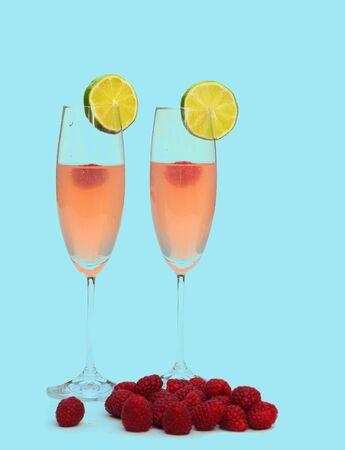 Raspberry cocktail on blue