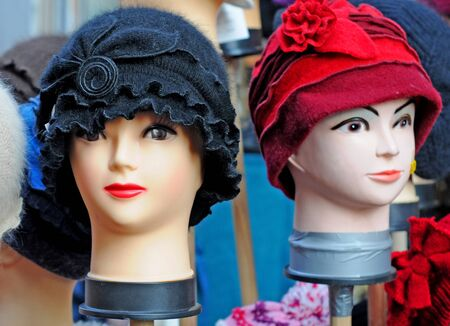 manequin: Dummy heads showing hats, shallow depth of field