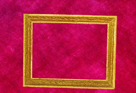 Antique golden frame on red textured background photo