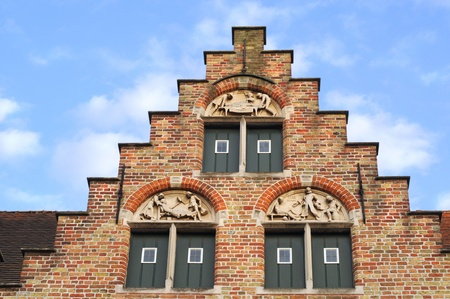 Crow-stepped gable with antique medical sculptures, Bruges, Belgium, Europe Editorial