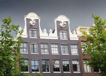 gable house: Dutch gable house on a stormy day, Amsterdam