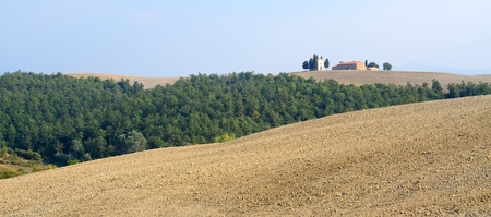 Tuscan landscape with fields, trees and farmhouse photo