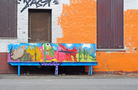window graffiti: Colourfull graffiti bench and house, Doel, Antwerp, Belgium, Europe Editorial