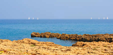 Seven sailboats on the blue adriatic sea in Italy photo