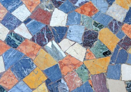 Irregular colourful mosaic pattern with different sorts of marble found on an antique floor in Rome, abstract background photo