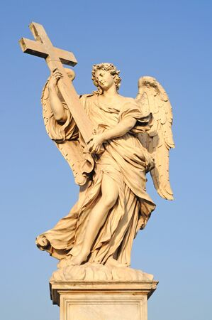 angel with the cross on ponte sant angelo or bridge of hadrian in rome, italy, europe
