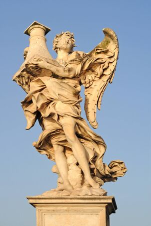 Angel with column against blue sky on Ponte San Angelo or bridge of hadrian in Rome, italy, europe photo