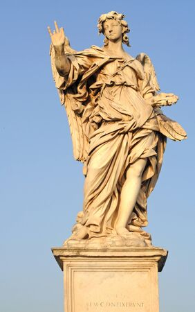 angel with the nails on ponte sant angelo or bridge of hadrian in rome, italy, europe photo