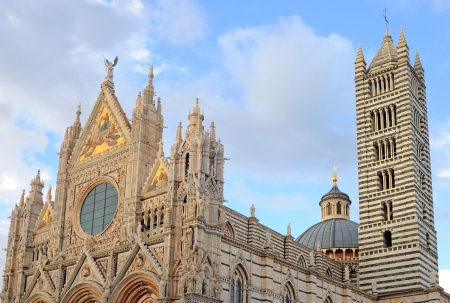 duomo or cathedral against clouded sky in siena, italy, europe Stock Photo